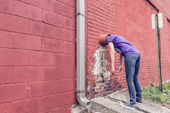 Trying too hard to be liked - head in wall