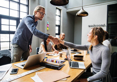 Collaboration in the workplace - handshake