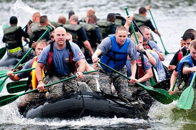 Delegating leadership teamwork - boat paddling